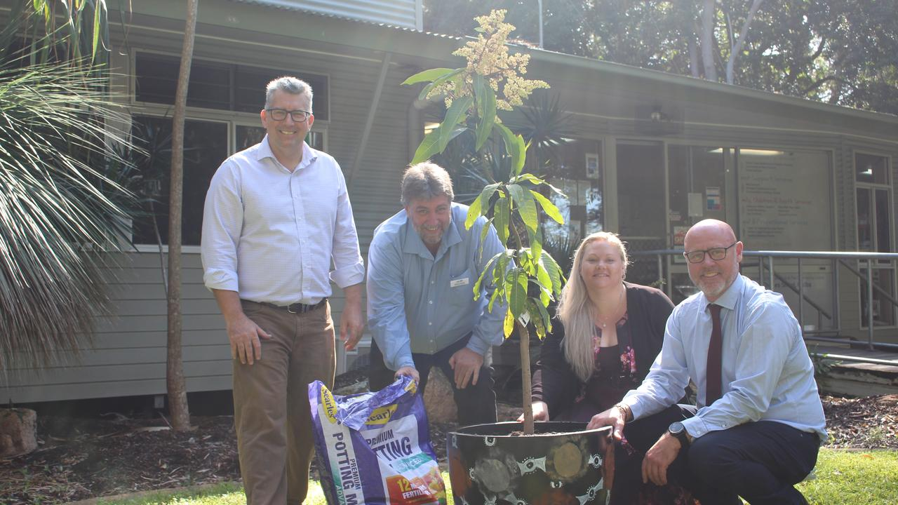 Federal Member for Hinkler Keith Pitt, LNP candidate for Hervey Bay Steve Coleman, Hervey Bay Neighbourhood Centre chief executive officer Tanya Stevenson and Deputy Mayor Darren Everard planting a tree to celebrate a new wellness centre.