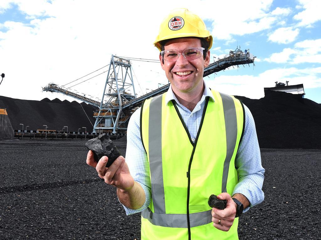 Nationals Senator Matt Canavan holds Queensland coal at the Port of Brisbane. (AAP image, John Gass)