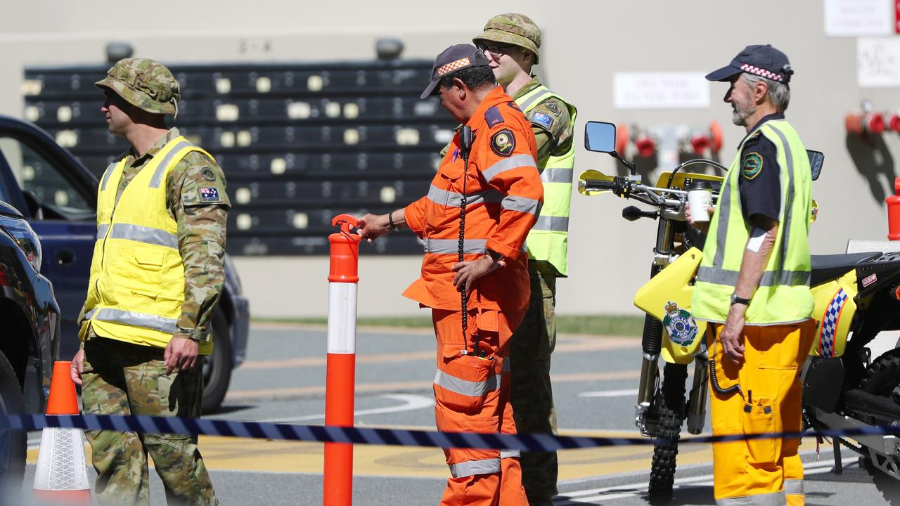 ADF personnel with police and the SES at the Queensland border. Picture: NIGEL HALLETT