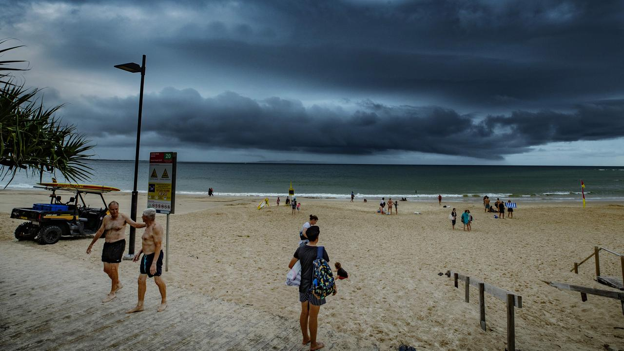 Beachgoers leaving Noosa Main Beach after it was closed due to severe thunderstorm warnings earlier this year. Photo: Lachie Millard