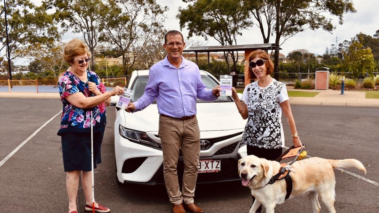 SWEET VICTORY: Cheryl Callaghan, State Member for Bundaberg David Batt and Helen Willett, with assistance dog Hank.