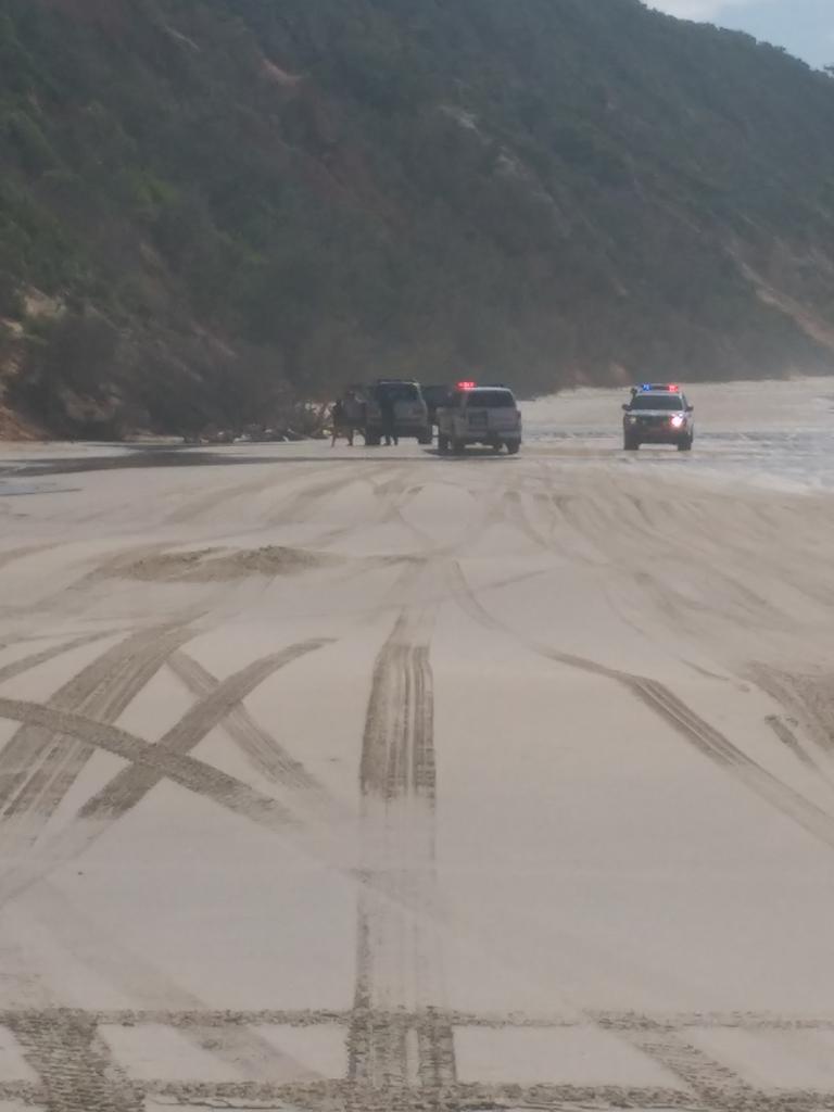 Police patrolling Teewah Beach