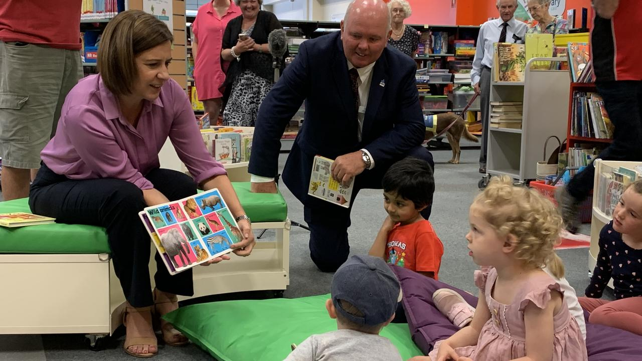 READING PLAN: (L) State Opposition Leader Deb Frecklington with LNP candidate for Maryborough Denis Chapman reading to kids at Maryborough library. Photo: Stuart Fast