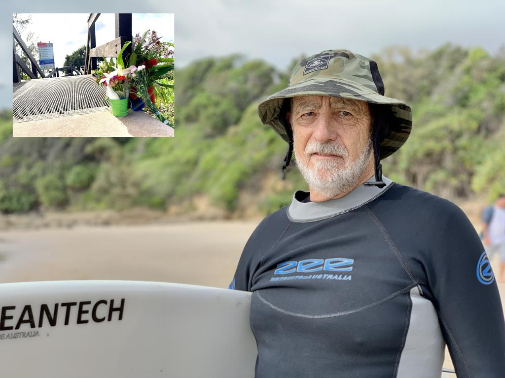 Local surfer Col Nation at Coolum Beach's First Bay, which was marred by tragedy on Monday when a young mum drowned. Flowers have been laid there in her memory. Photos: Patrick Woods