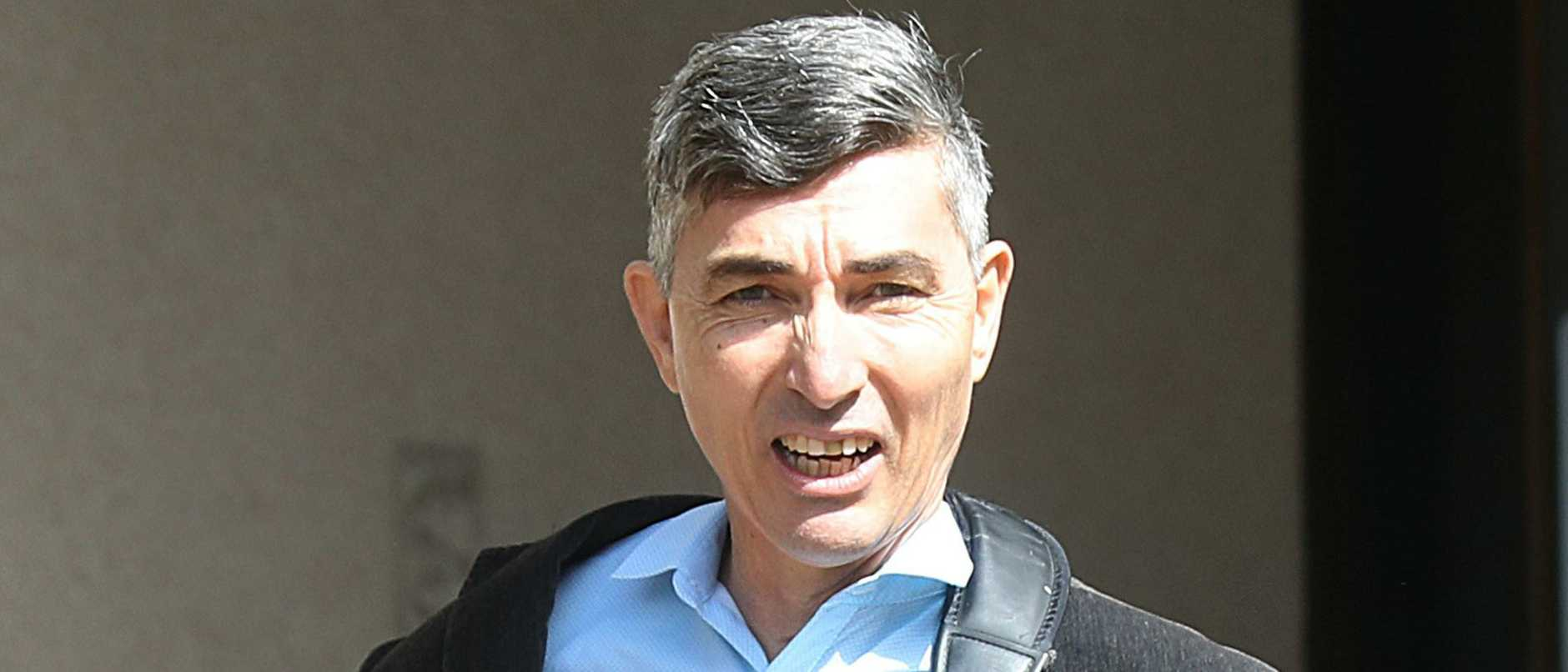 A once high-flying executive convicted of raping a woman in a motel room has been hospitalised after being severely bashed in jail.