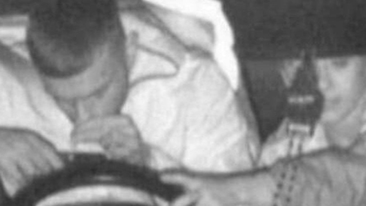 A man could be slapped with up to 11 demerit points after police say say was he was snapped allegedly sniffing a substance off his phone while driving.