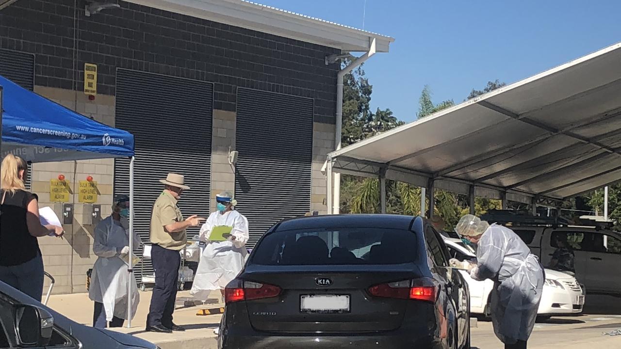 Rockhampton residents lining up outside Rockhampton Base Hospital for COVID-19 testing. (file photo)