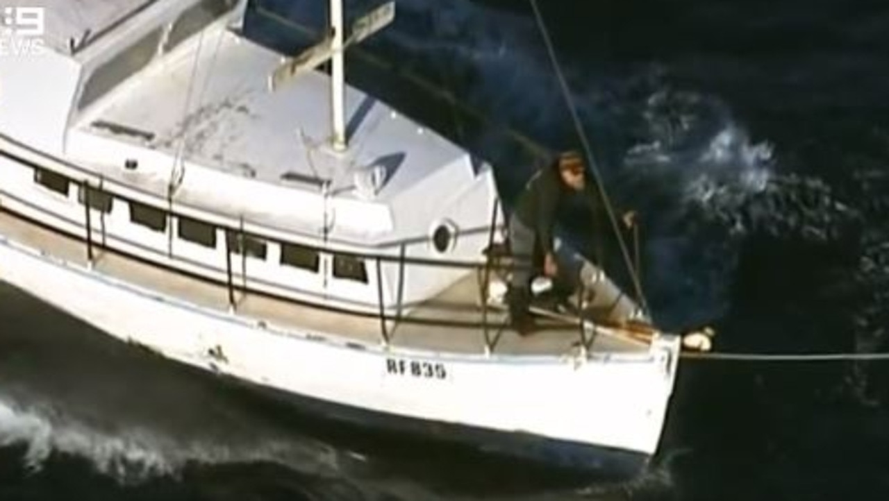 Boaties Tony Higgins and Derek Robinson aboard their boat found off the Coorong coast after almost a week at sea. Their vessel was towed back to Victor Harbor by SA Police. Picture: Nine News Adelaide