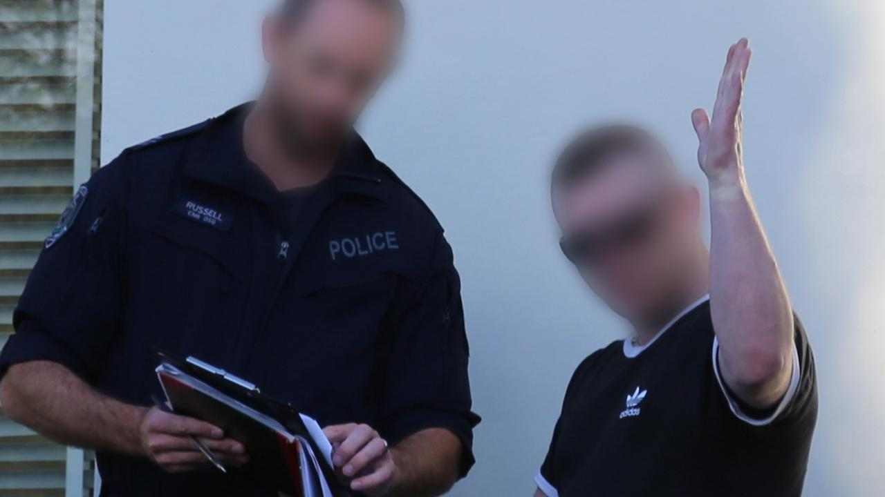 A police officer speaks to the male resident. Picture: NSW Police