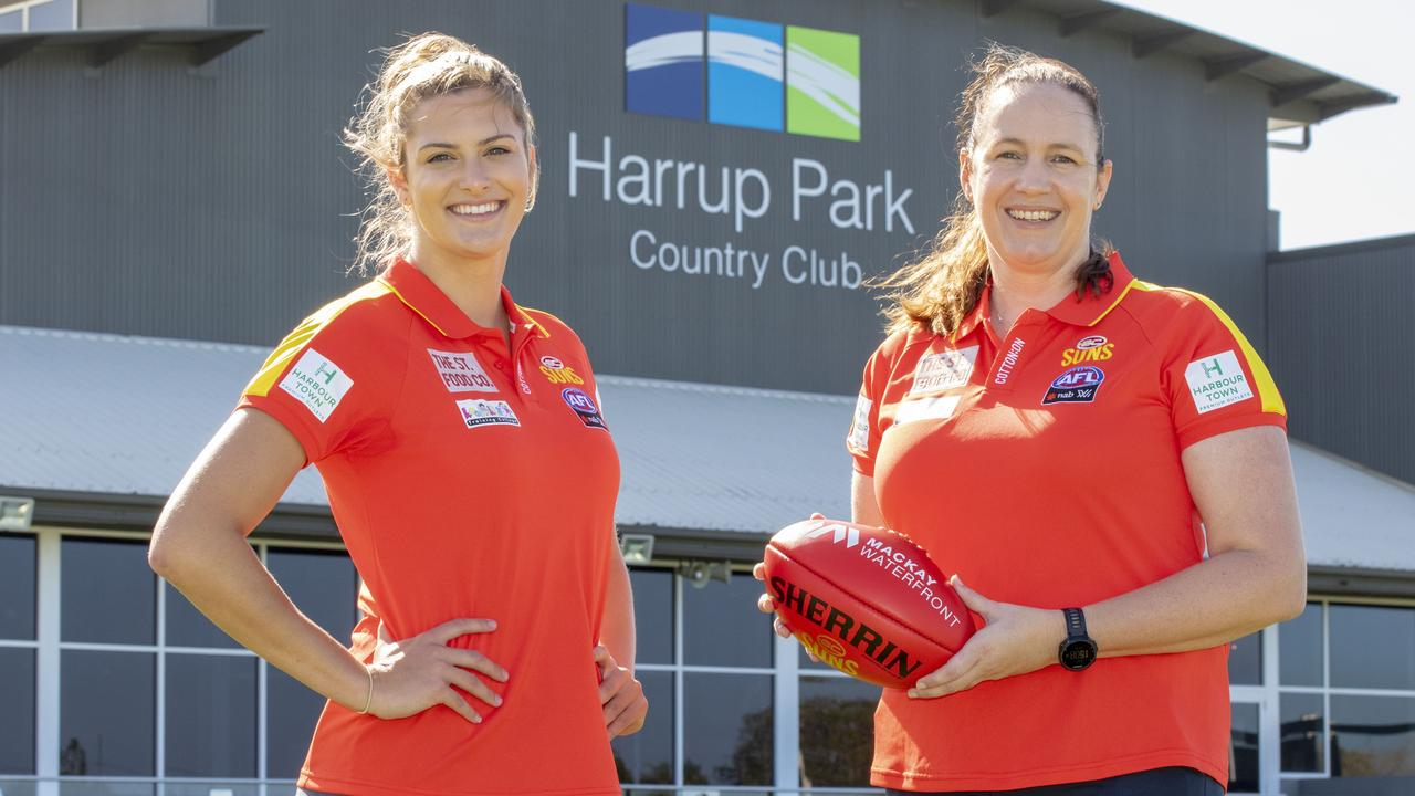 Gold Coast Suns player Lauren Bella with head of women's football Fiona McLarty at Harrup Park / Great Barrier Reef Arena. Photo: Lee Brake
