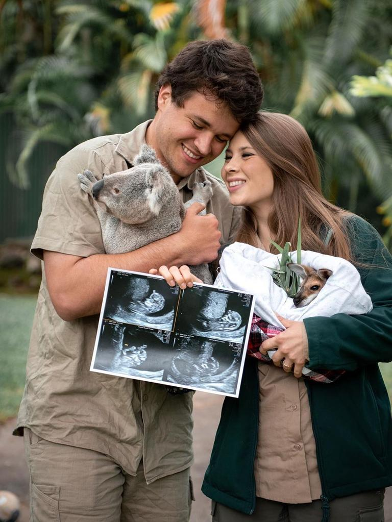 Chandler Powell & Bindi Irwin holding baby scans, - The animal joeys we care for are excited to meet our human joey. Baby Wildlife Warrior is about the size of a hummingbird now! We can't wait to teach our little one about the importance of protecting our planet and the beauty of the wildlife and wild places we love so much. Thank you for your kindness and support on this magical journey - Ph