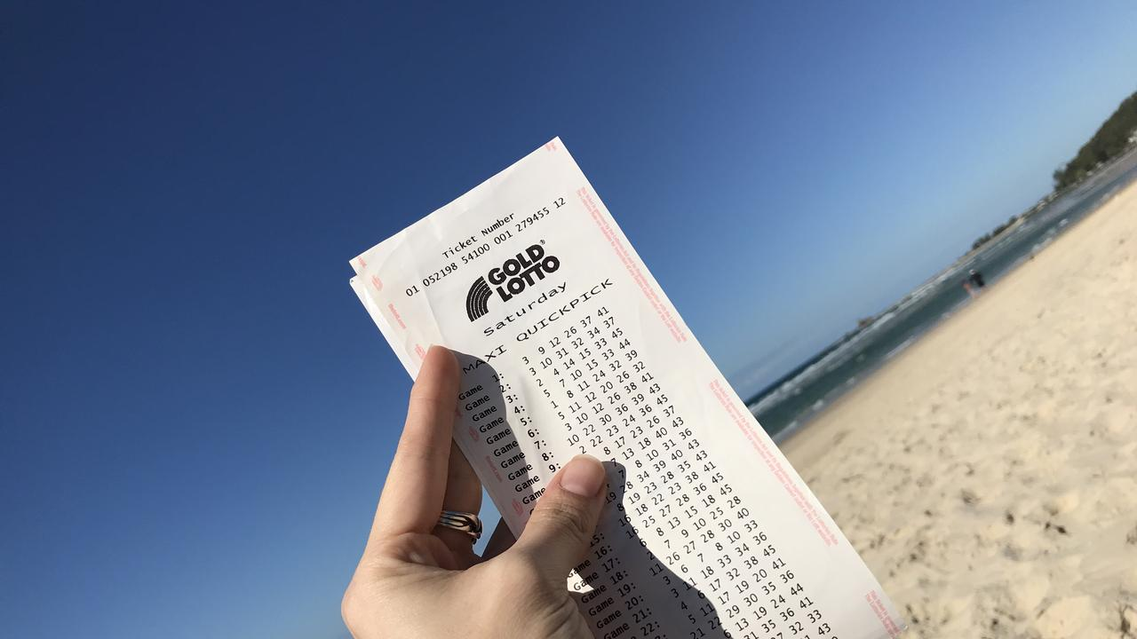 A Tweed couple have won the lotto while on vacation around Australia.