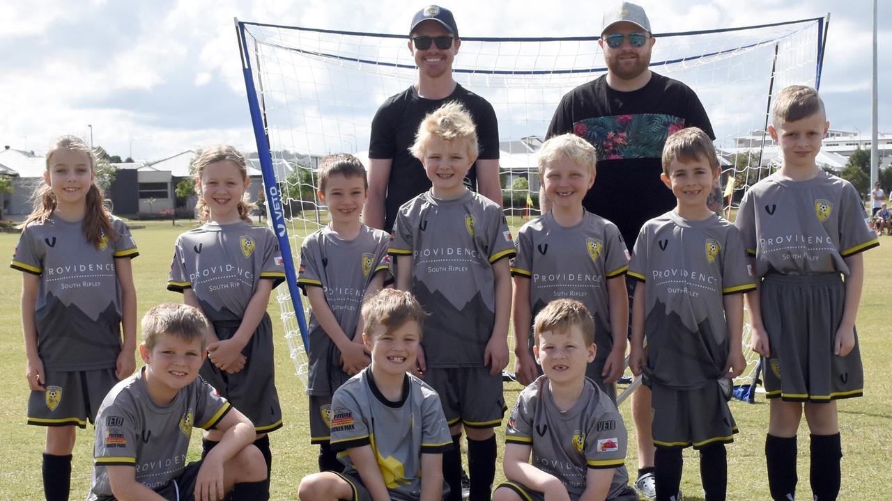 The Ripley Valley U8 Rogues soccer team with coaches Richard Ireland and Scott Murphy at the club's home field at South Ripley. Picture: Gary Reid