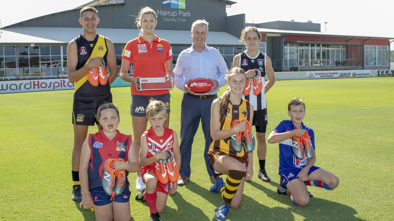 Gold Coast Suns AFLW player Lauren Bella (second from left) with Mackay Mayor Greg Williamson and junior representatives from AFL Mackay clubs at Harrup Park / Great Barrier Reef Arena. Photo: Lee Brake – Mackay Regional Council