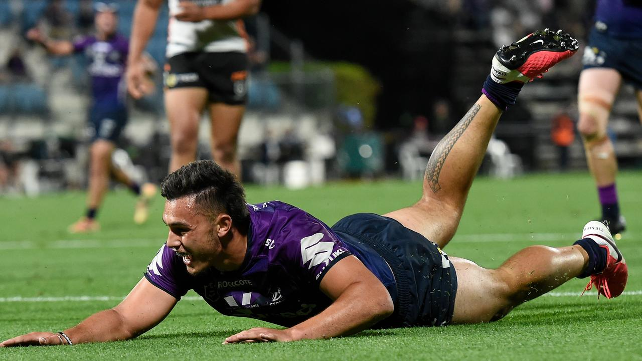 Tino Faasuamaleaui of the Storm scores a try during the round 19 NRL match against Wests Tigers at Sunshine Coast Stadium on September 19. Picture: Matt Roberts/Getty Images