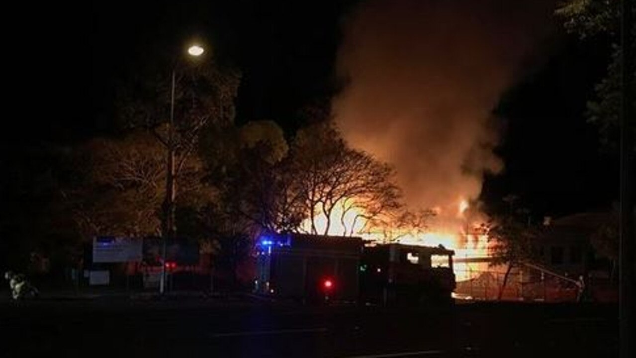 Firefighters battle a structure fire next to the Newmarket State School. Picture: Olivia Mowat