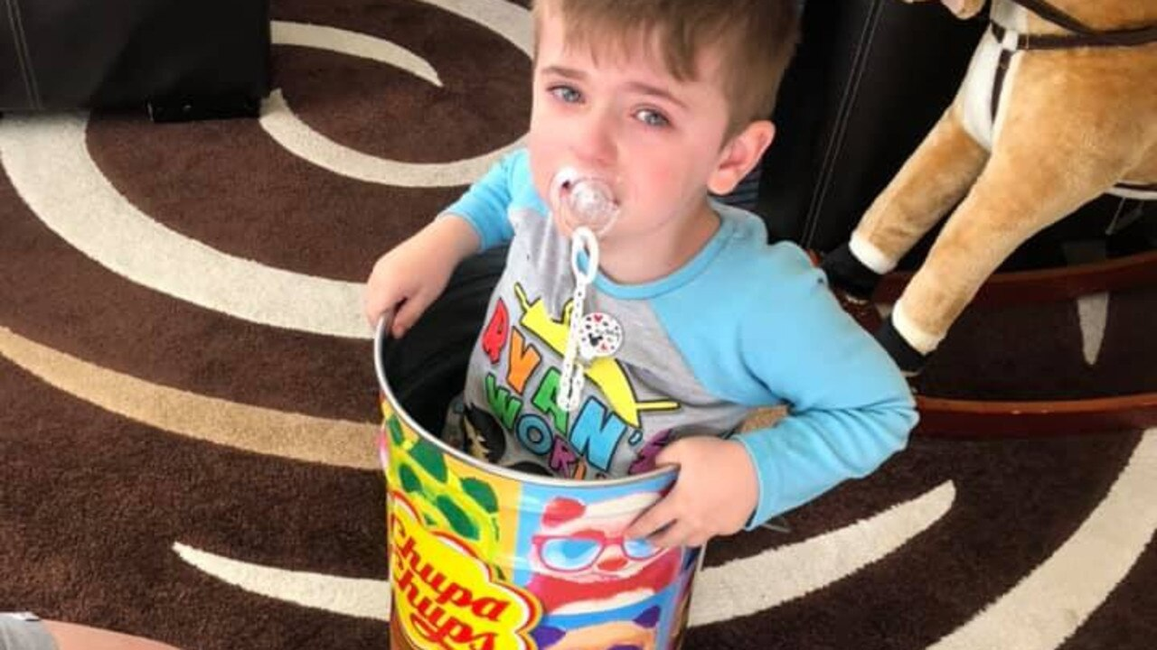 Melbourne boy Alessio, 4, needed to be rescued by firefighters after he got himself stuck in a Chupa Chups tin. Picture: Facebook/Sheree Caruso