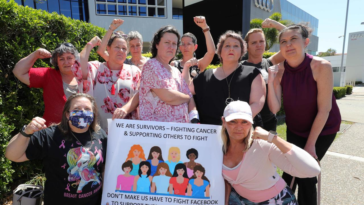 Spokesman Nicole Drummond (centre) and members of the Womens Cancer Support GC protesting at their treatment by social media giant Facebook. Picture: Glenn Hampson