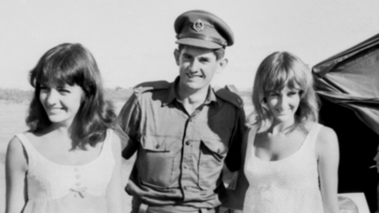 2nd Lieutenant Kevin Lunny of the 1st Battalion, The Royal Australian Regiment (1RAR), with singers Pat Carroll (left) and Yvonne Barrett in South Vietnam on New Year's Eve, 1965. Picture Australian War Memorial.
