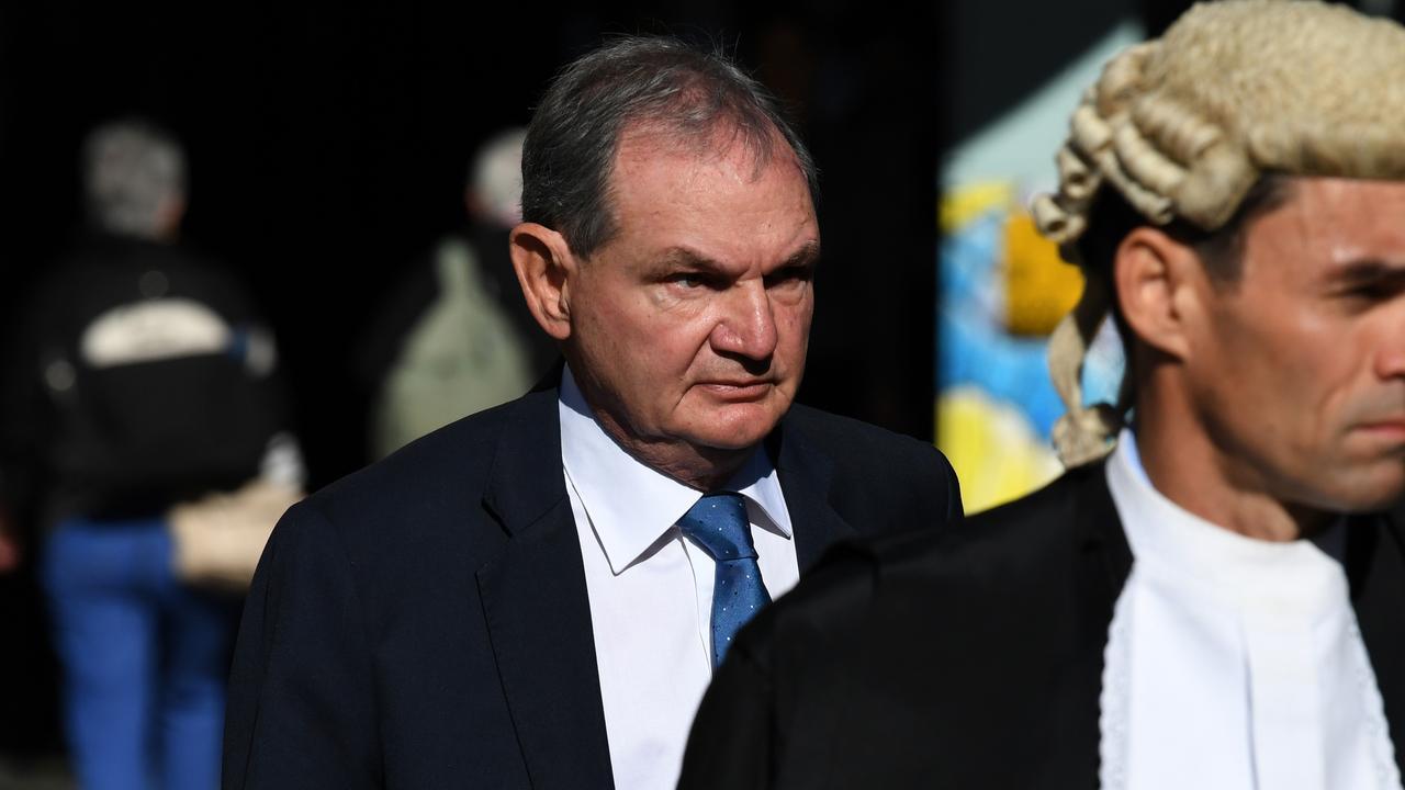 Former Ipswich mayor Paul Pisasale (left) arriving at the District Court in Brisbane in July, 2019 (AAP Image/Dan Peled)