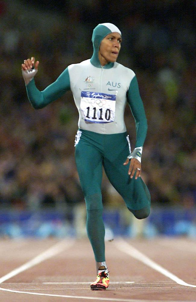 Cathy Freeman wins a gold medal in the Womens 400m at the 2000 Sydney Olympics. Picture: Phil Hillyard