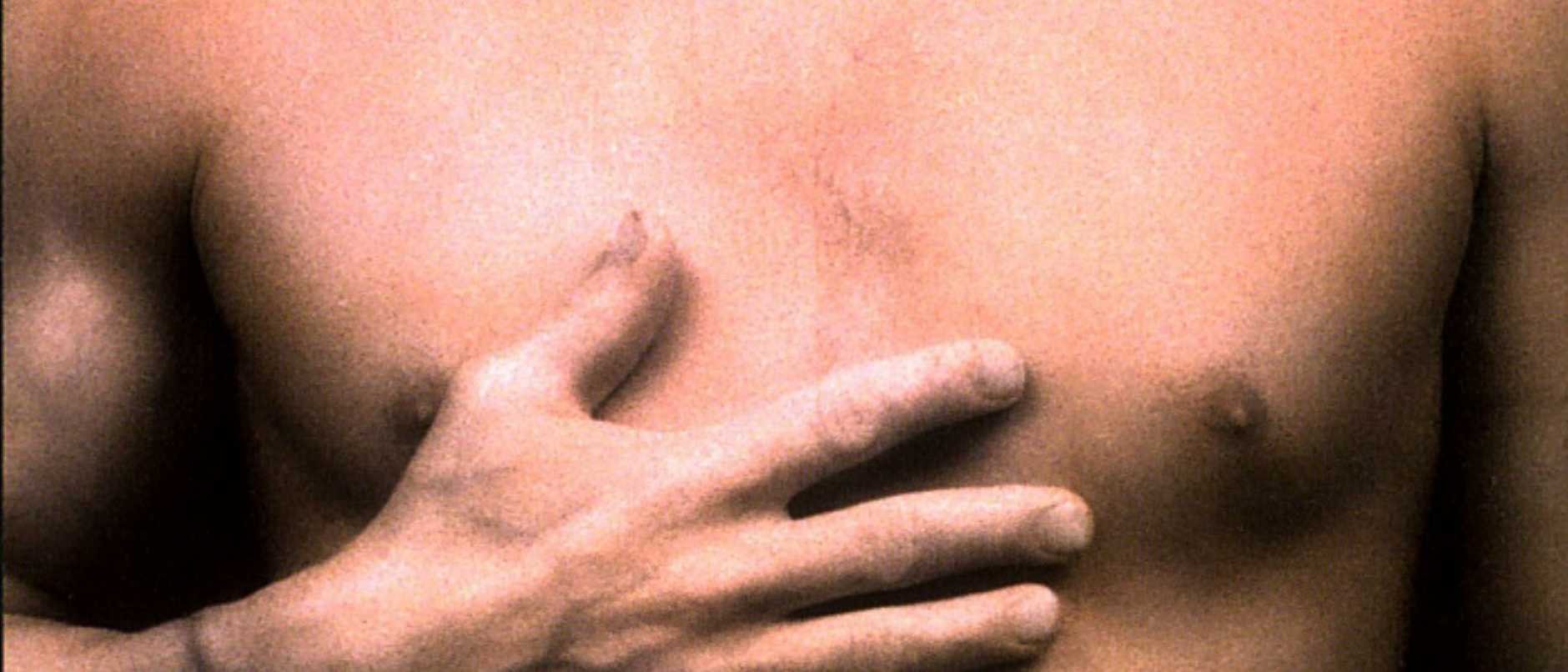 Hand on chest of man. generic bare chested hands nudity