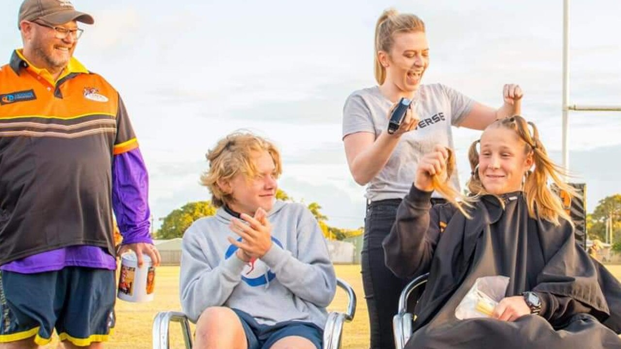 Chris Auguston watch as his son Jack Auguston, 15, left, and Donovan Ryan-Ellul, 15, had their hair shaved off by Amanda Rafferty to raise $4000 for the Mackay and Pioneer Valley Relay at the Wests Rugby Leagues Club, on Saturday September 12.