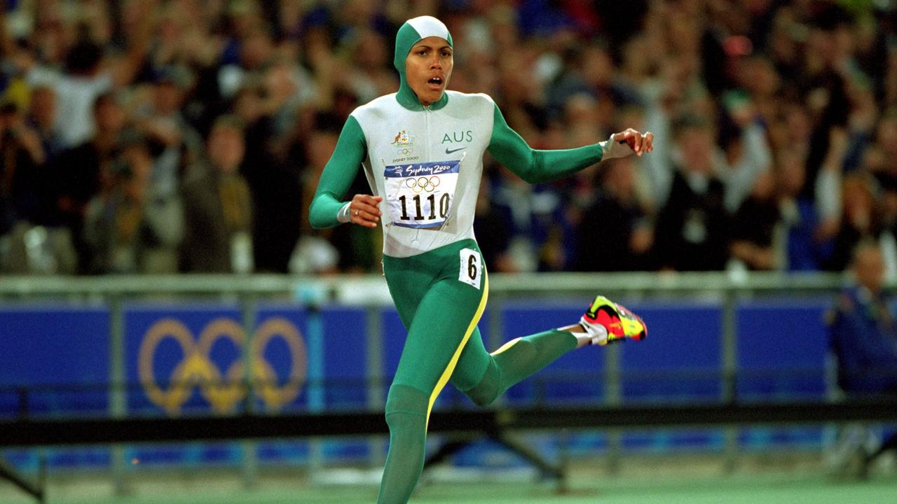 Cathy Freeman crosses the line to win gold in the women's 400m final at the Sydney 2000 Olympic Games. Photo: Mike Powell /Allsport