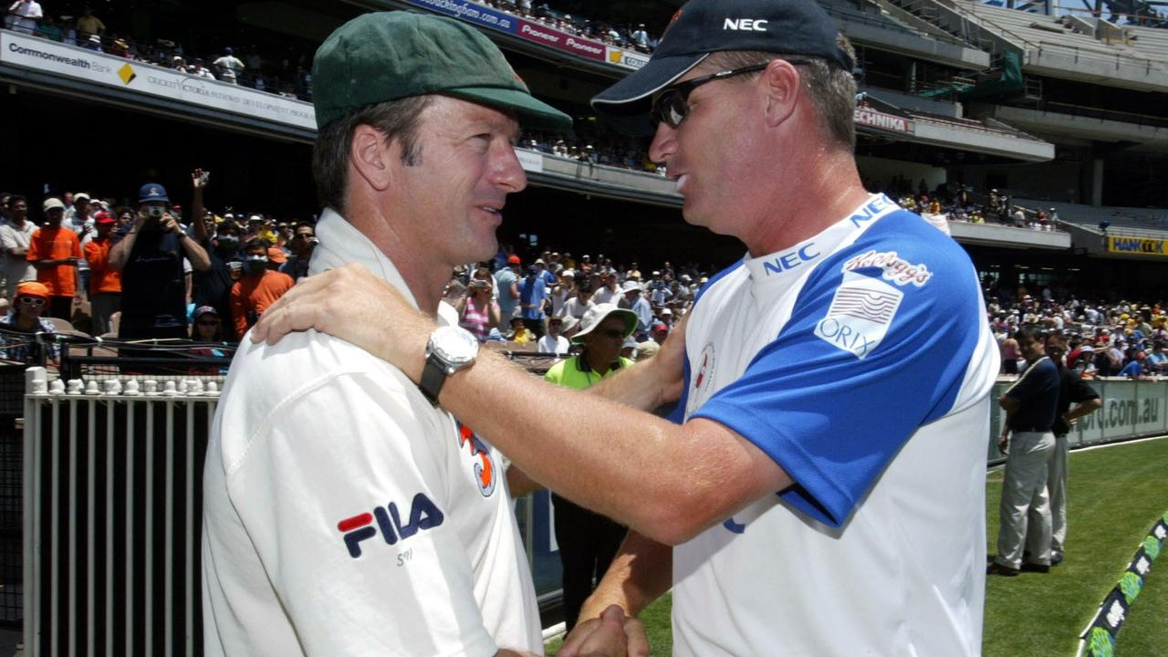 Jones shakes hands with fellow cricket legend Steve Waugh.