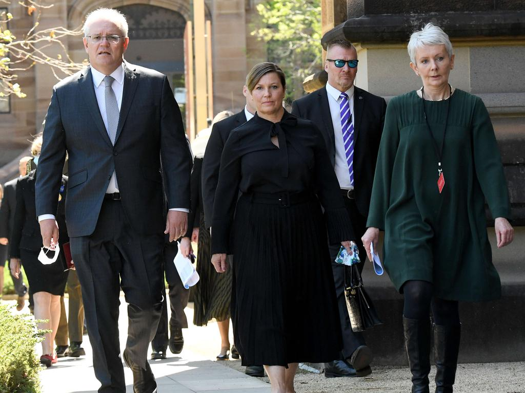 Prime Minister Scott Morrison (left) and wife Jenny Morrison (centre) are seen arriving at the funeral for the former NSW Premier. Picture: NCA NewsWire/Bianca De Marchi