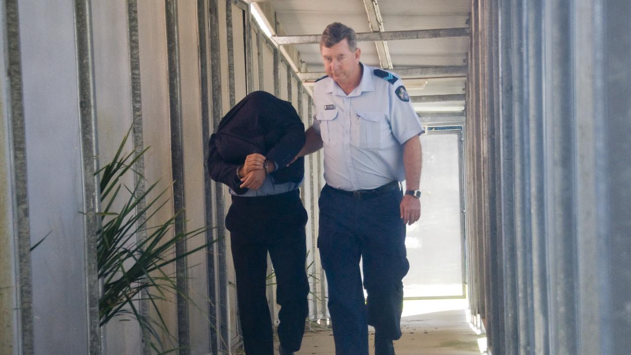 Husband of murdered woman Lisa Keem, Richard Giardina is led away from the Hervey Bay court.
