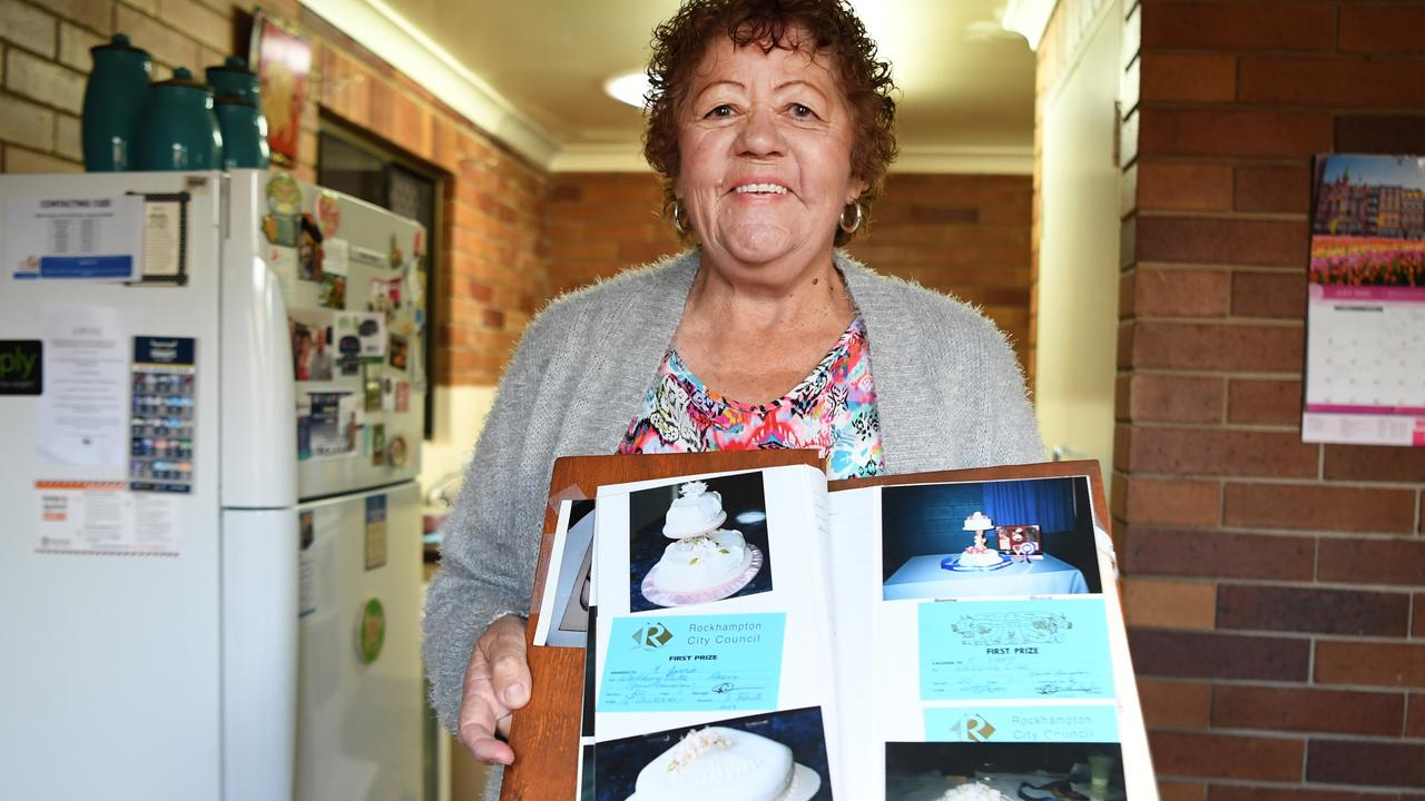 Evol Jarro with a photo album full of photos of her prize-winning cake creations. Photo: Jann Houley