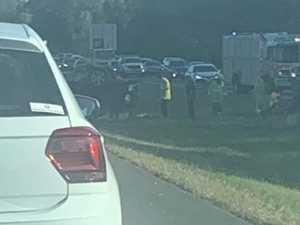 Traffic a 'mess' on Bruce Hwy after car flips