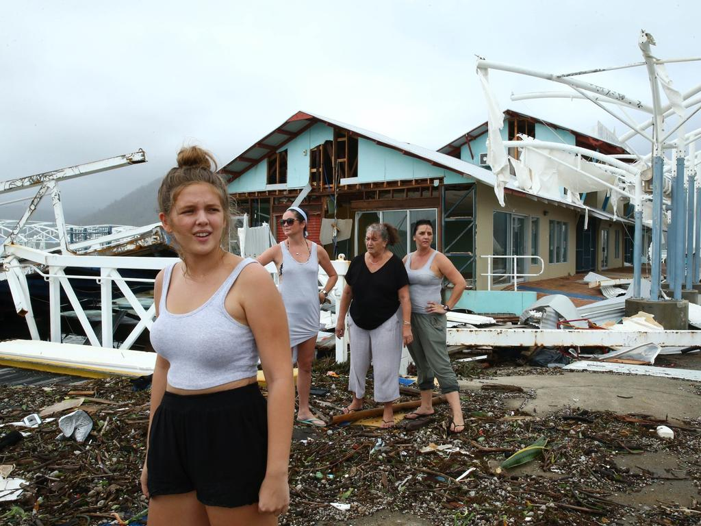 Airlie Beach residents Maika McDonald, Lauren Squires, Karen Gordon and Katelin Gordon survey the damage at Shute Harbour after Cyclone Debbie.