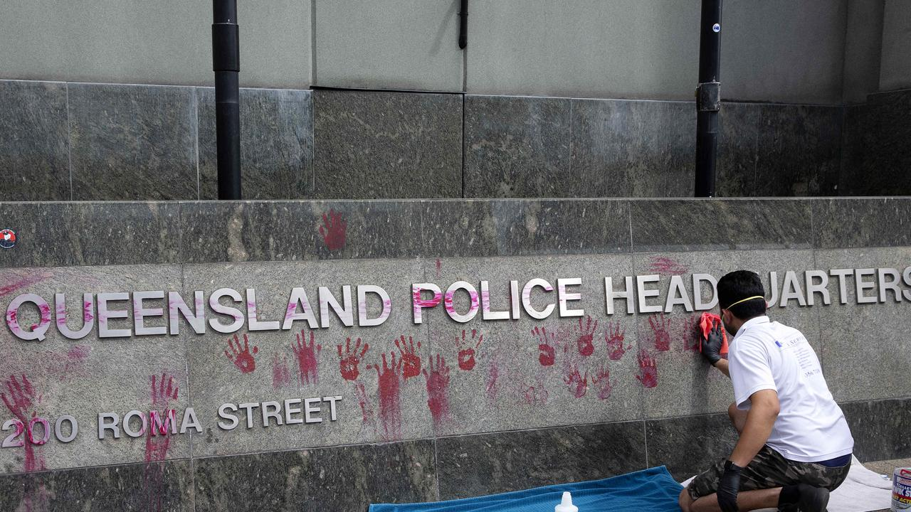 Handprints are cleaned off police headquarters after activists protested the death in custody of an Indigenous woman. Picture: Sarah Marshall/NCA NewsWire