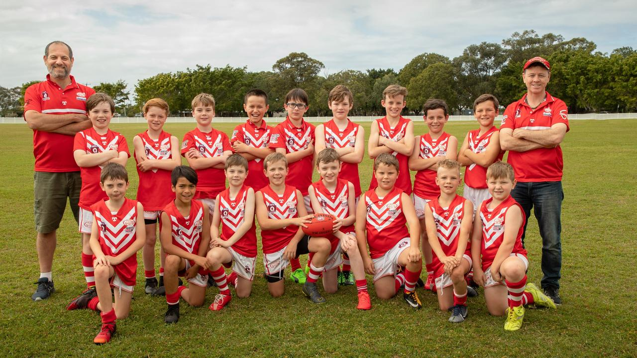 SUPER SQUAD: The coaches and the talented U10.5 players of the Lismore Swans Junior Australian football Club.