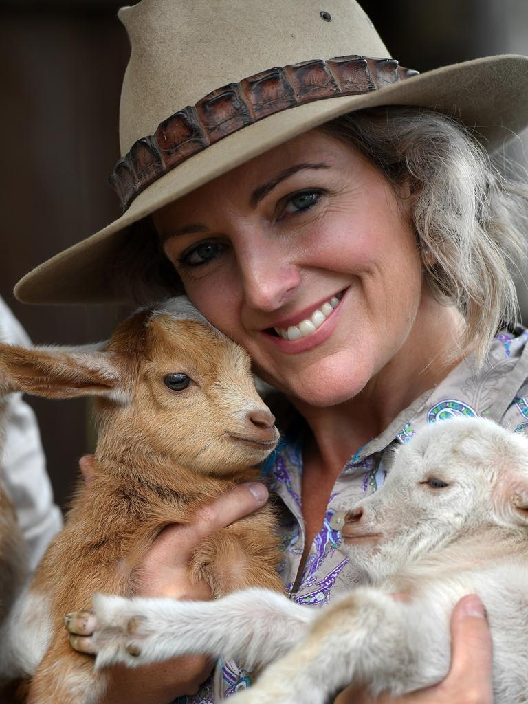 SPLITTERS SQUAD: Carly Clark with two baby goats at Splitters Farm. Picture: Mike Knott.