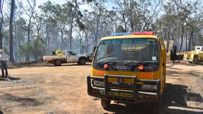 Behind battle lines of bush blaze near M'boro
