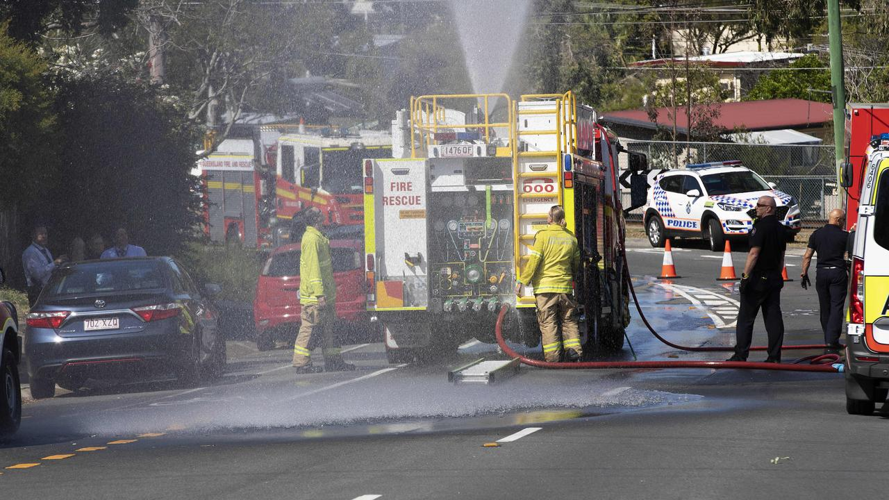 Firefighters and police are on the scene of the Woodridge house fire. Picture: News Corp/Attila Csaszar