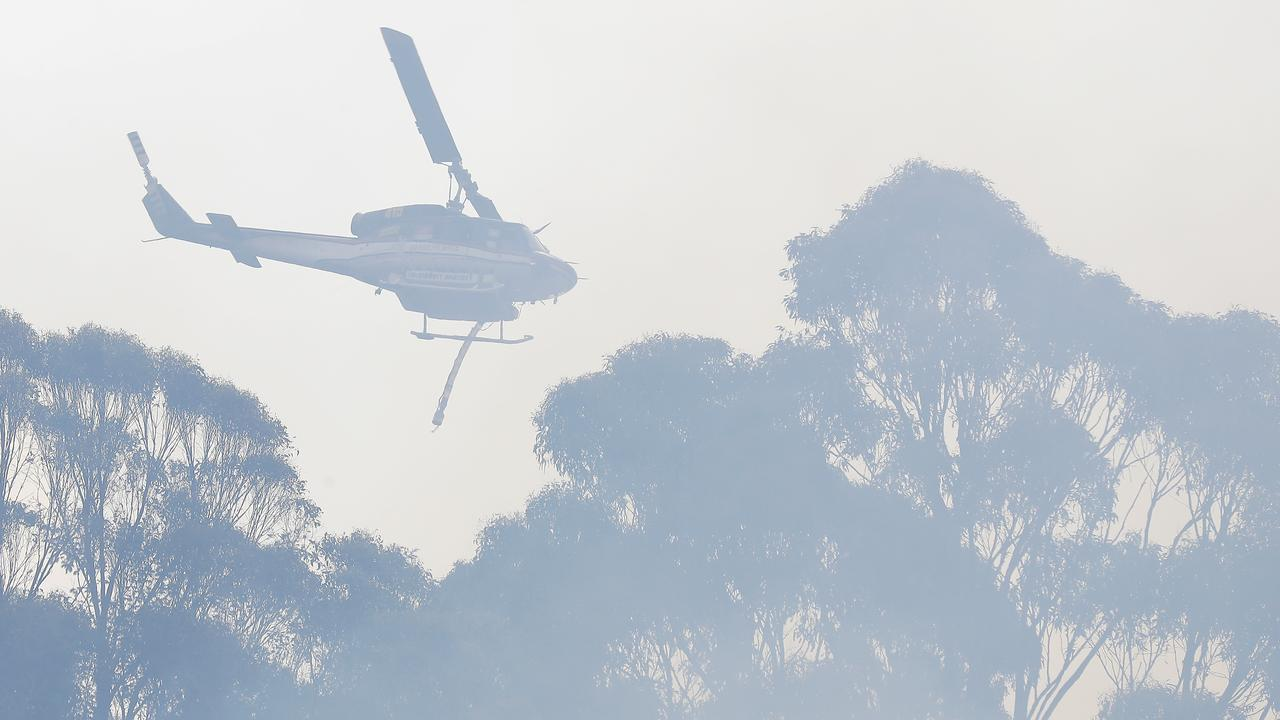 FILE PHOTO: A water bomber aircraft is working to contain a large grass fire at Mt Chalmers.