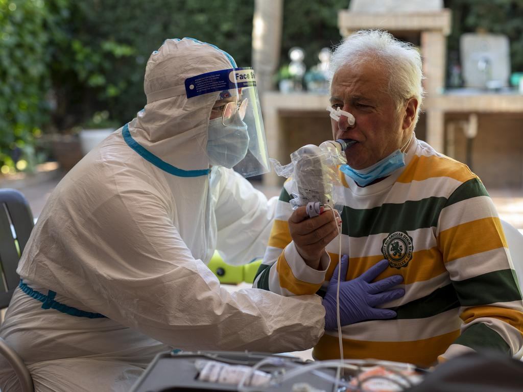 A physiotherapist tests the breathing of a coronavirus patient in Madrid. Picture: Pablo Blazquez Dominguez/Getty Images