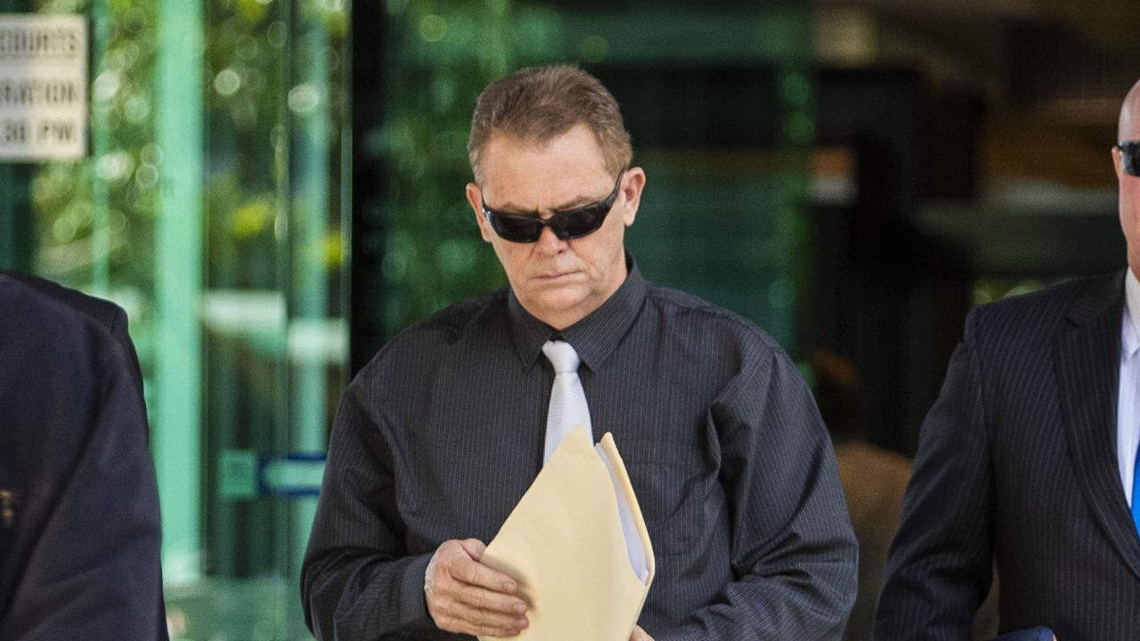 Senior Constable Neil Punchard leaves the Magistrates Court in Brisbane in October last year. (AAP Image/Glenn Hunt)