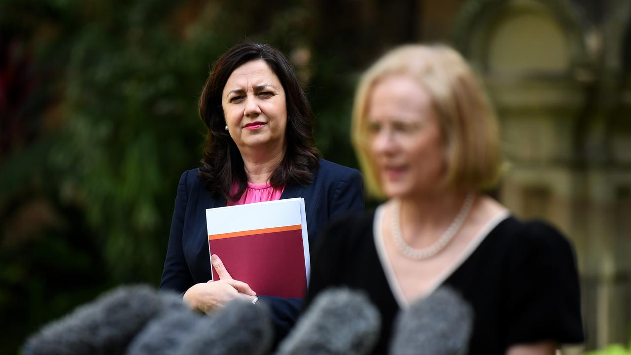 Queensland Premier Annastacia Palaszczuk (left) watches the Chief Health Officer Dr Jeanette Young as she speaks during a press conference at Parliament House in Brisbane. The Premier announced Queensland will open its borders to five NSW local government areas. Picture: NCA NewsWire / Dan Peled