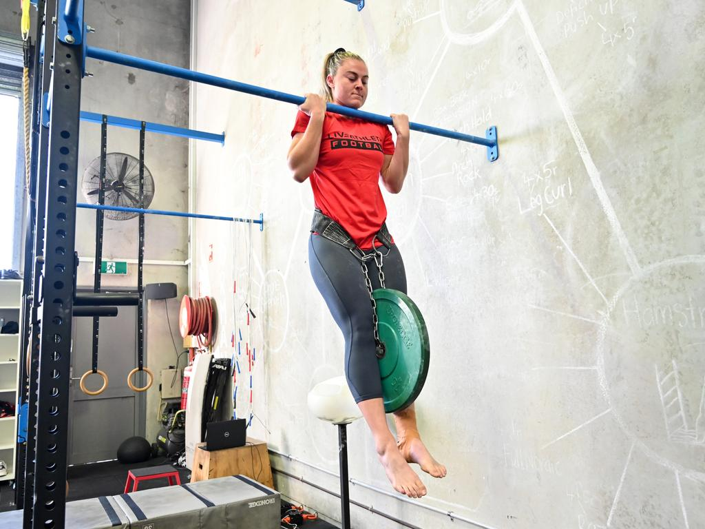 Georgia Page (Dragons) working on the chin-up bar. Picture: Grant Trouville