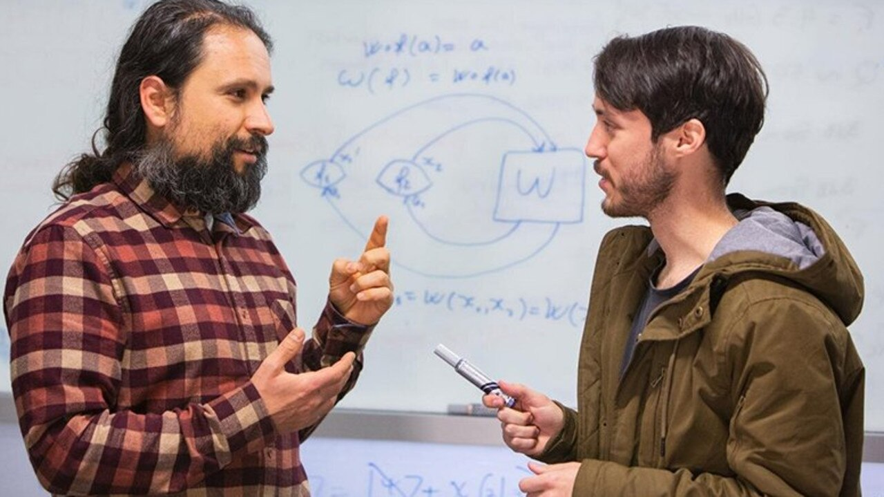Dr Fabio Costa, left, with Bachelor of Advanced Science student Germain Tobar. Picture: UQ