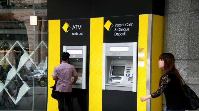 Suspicious man with baseball bat at bank's ATMs