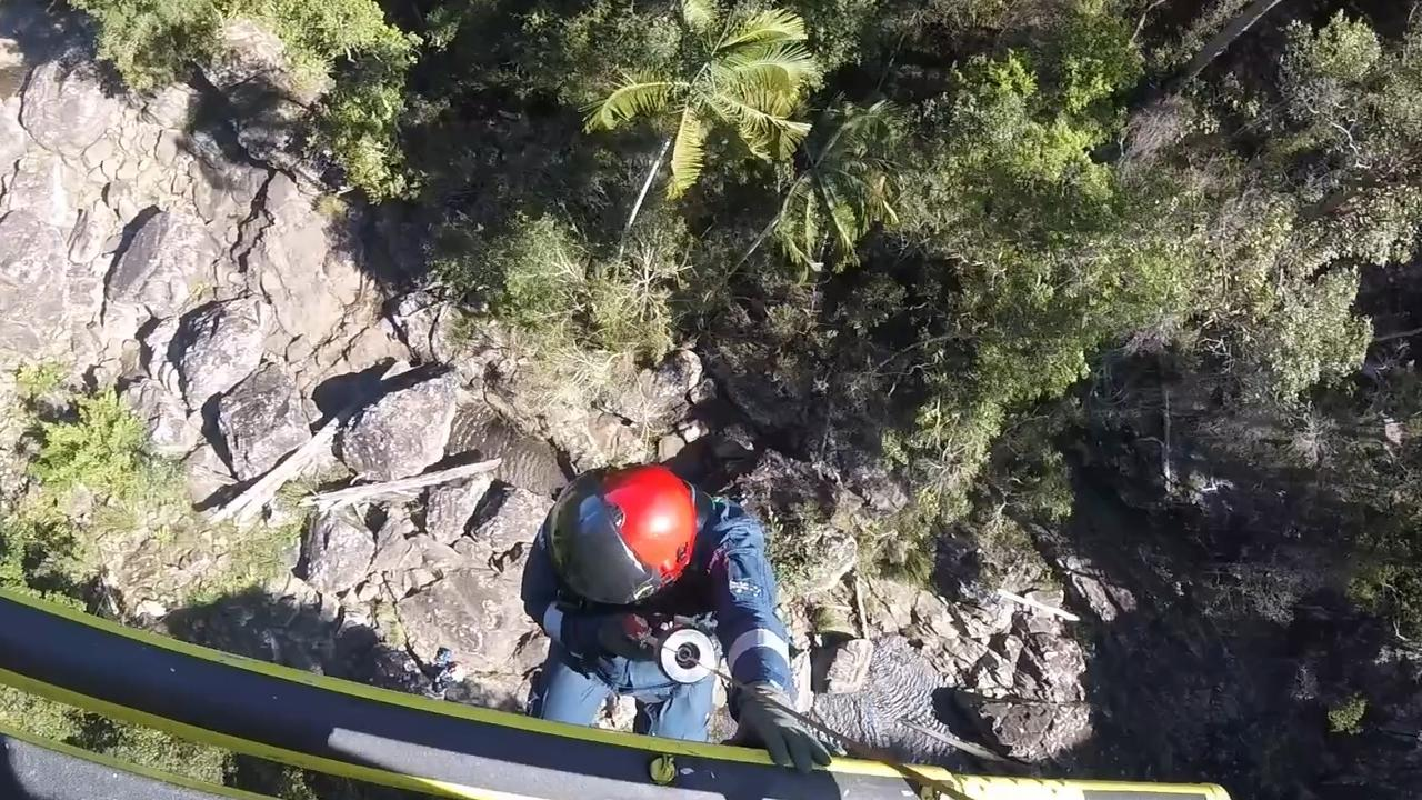 The Sunshine Coast-based RACQ LifeFlight Rescue crew winched an injured man out of a forest, northwest of Woodford, after he fell about 6m while walking. Photo: RACQ LifeFlight Rescue