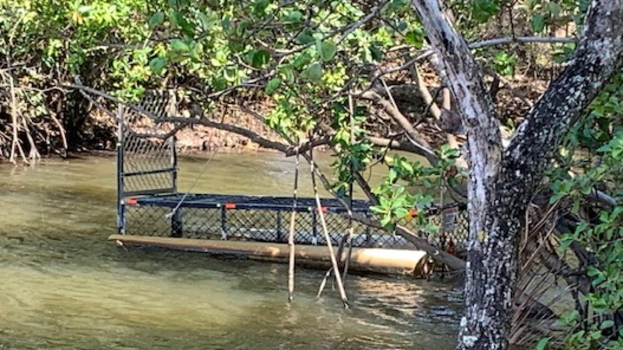 A crocodile trap has sat for months where a 2.5-3m crocodile ate a dog and has been spotted sunning itself on a bank at Palm Cove. PICTURE: SUPPLIED
