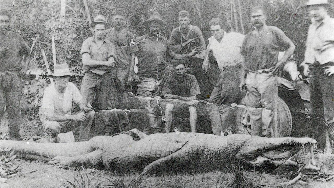KILLER CROC: Posing with the crocodile that killed two young girls on their way to school are from left, Fred Murray, G. Gallagher, T. Biggs, Ted Zunker, Bill Adams, R. Pearce (sitting), P. Butterwirth, Bill Schofield, Ted Rennels and Mr Patterson. 1933.Photo Daily Mercury Archives
