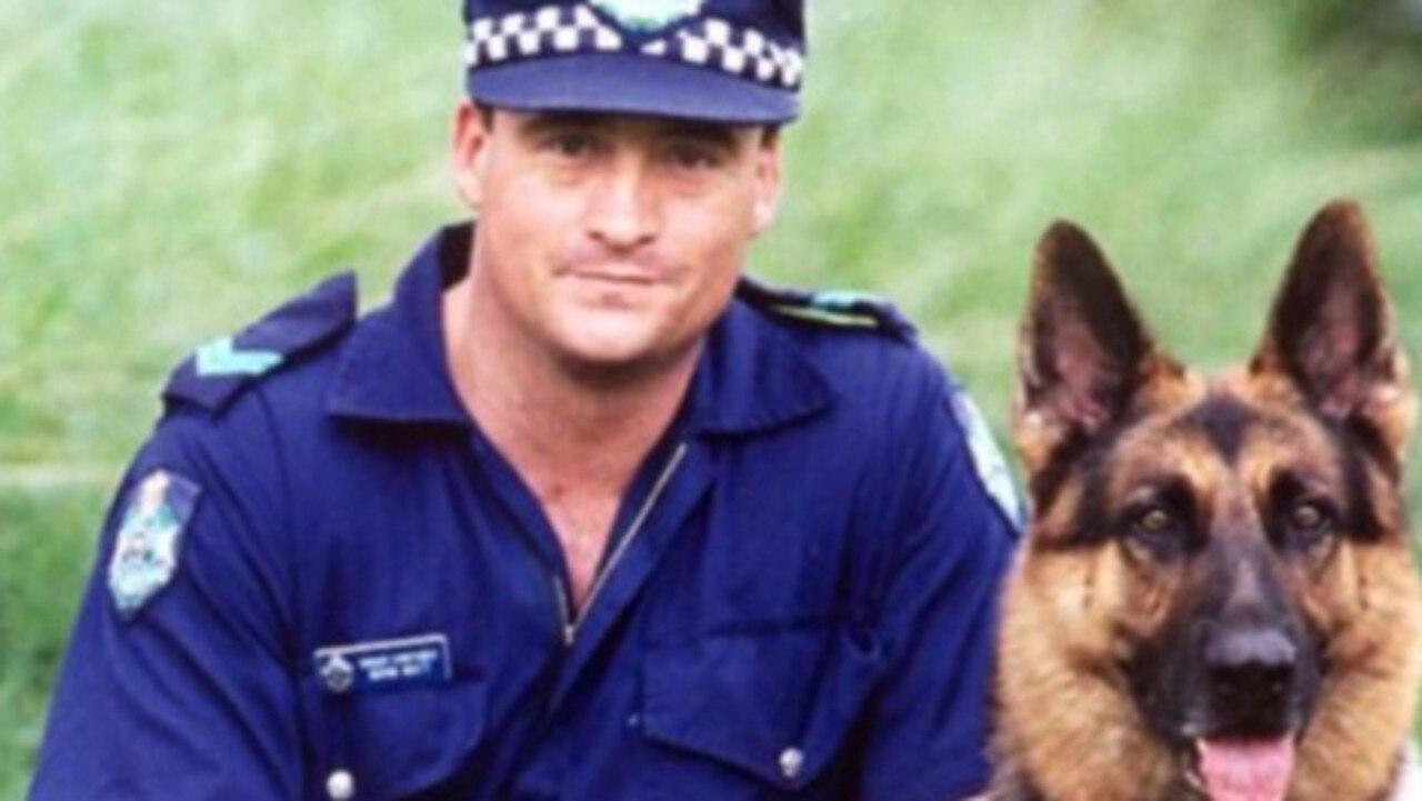 Senior Constable Norman (Norm) James Watt of the Rockhampton dog squad with his dog 'Zeus'.